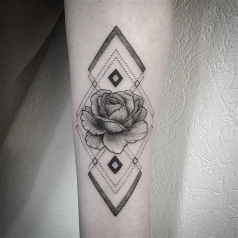 picture of geometirc pattern and a rose on an arm