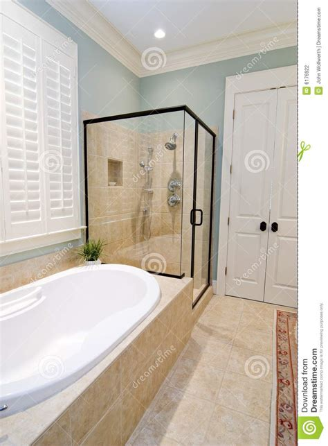 bathtub or shower which is better bathroom with glass shower and tub stock photography