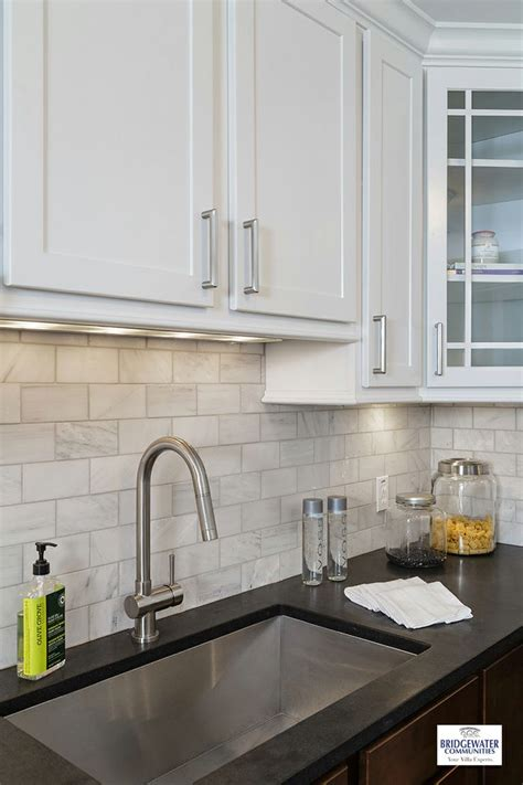 marble kitchen backsplash a beautiful exle of two tone cabinetry with elegant