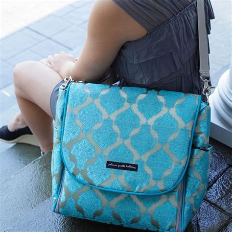 baby rolled off the couch exclusively posh mosaic roll boxy backpack by petunia and