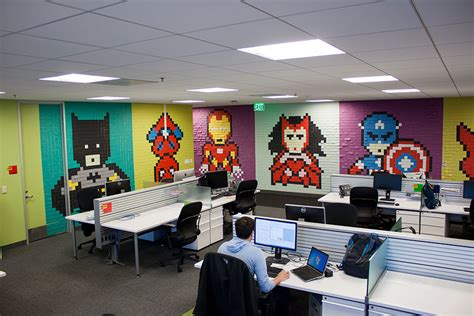 bukalapak office creative agency staff installs superhero murals on their