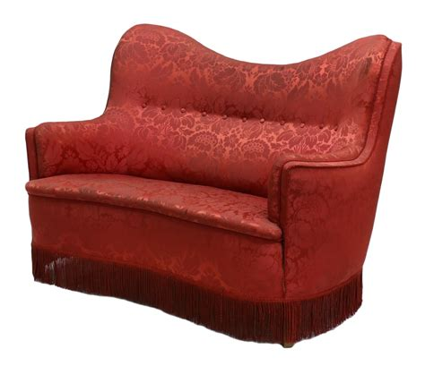 red floral sofa red floral brocade fringed curved sofa important two