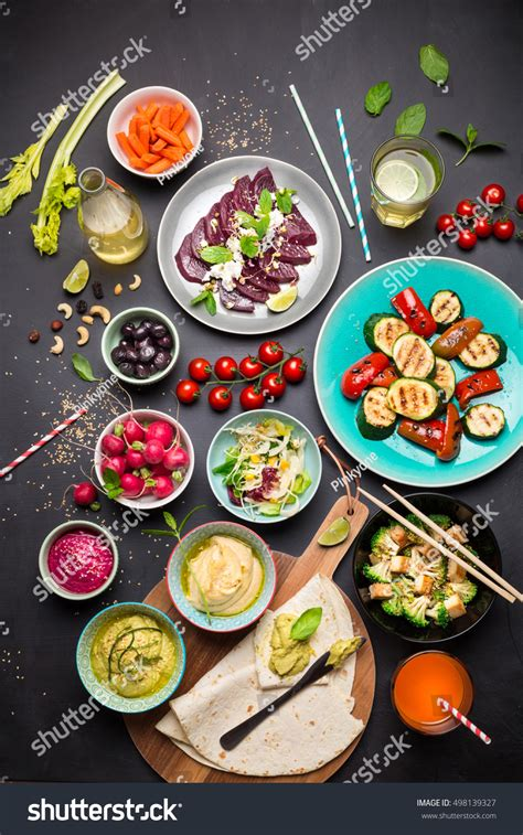 My Kitchen Table 100 Vegetarian Feasts by Colorful Vegetarian Feast Dinner Table Above Stock Photo