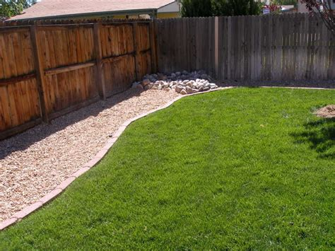 Backyard For Dogs Landscaping Ideas by Pebble Fence Trail Backyard Project