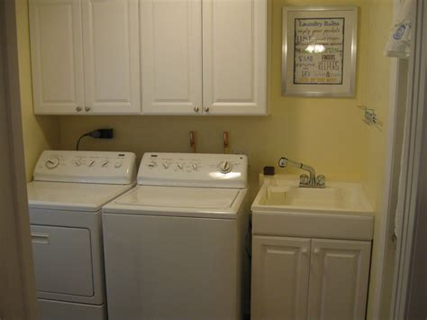 cabinets above washer dryer cabinet the washer dryer starter home ideas