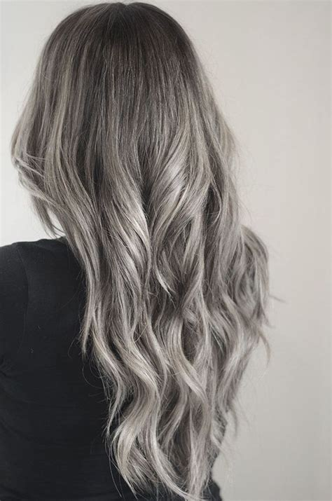 dirty blonde hair with black highlights preparing for silver highlights and dip dye hair styles