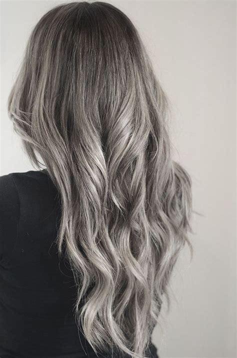 pics of dark blonde silver hair preparing for silver highlights and dip dye hair styles
