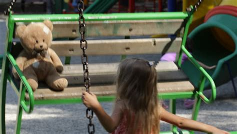teddy plays on the swing child swing footage stock clips videos