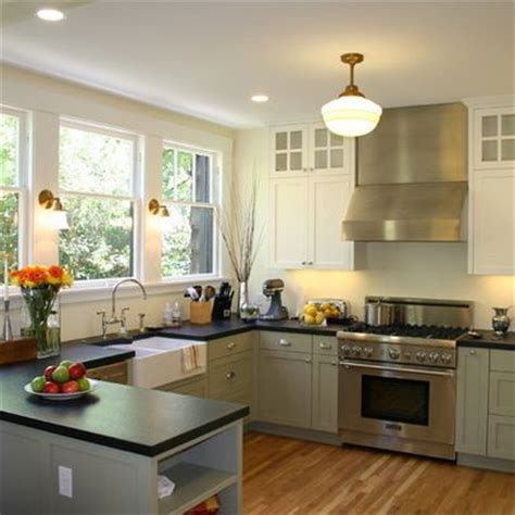 Kitchen Cabinets For Less by Island Vs Peninsula Which Kitchen Layout Serves You Best