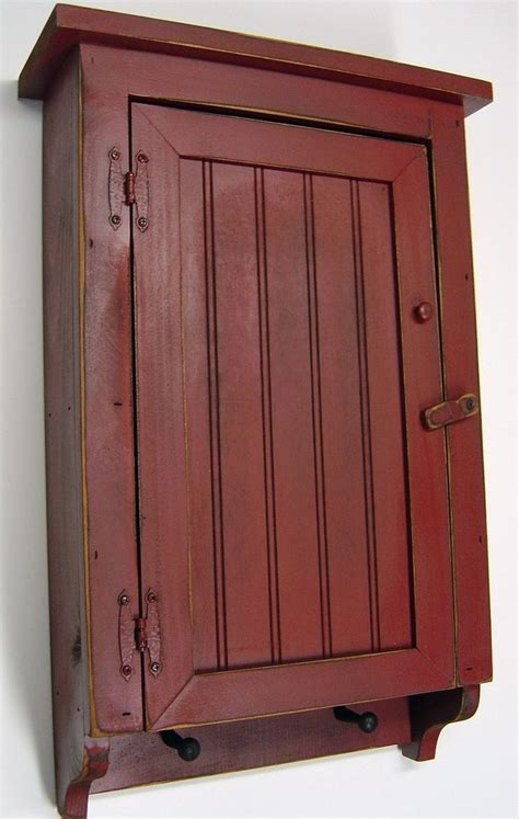 primitive bathroom wall cabinets amazon com cabinet primitive country rustic wood beadboard face with pegs barn red
