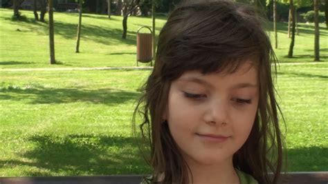 preteen luiza model sad preteen girl sitting on swing stock footage video