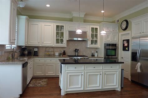 White Kitchen Cabinets With Different Color Island White Cabinets With Granite On Island With Different Granite Elsewhere Mikey S
