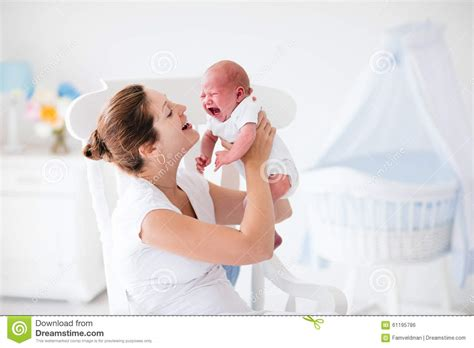 comforting a crying baby mother holding newborn baby boy hot girls wallpaper