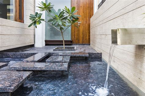 house fountain design a sleek modern home with indian and an interior courtyard beautiful outdoor fountain