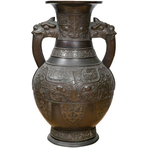 Vintage Etnik Cina Se 10 large archaistic black patina bronze vase for sale at 1stdibs