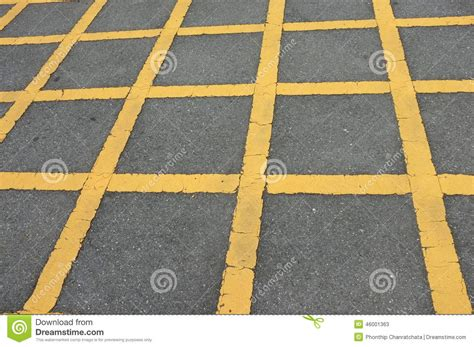 pattern of yellow lines on the roadway road asphalt texture with lines yellow pattern stock photo