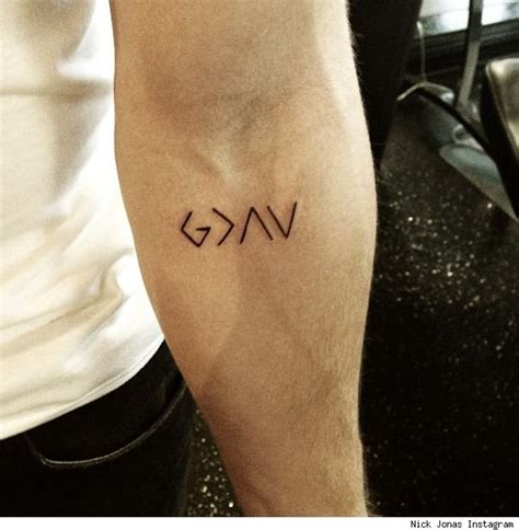 tattoo my photo up to down nick jonas shows off new tattoo what does it mean cambio