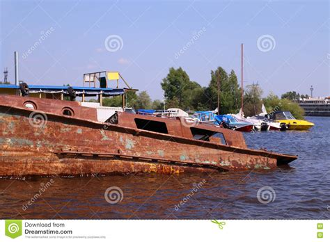 boat motors river old abandoned rusty boat in river and new motor boats
