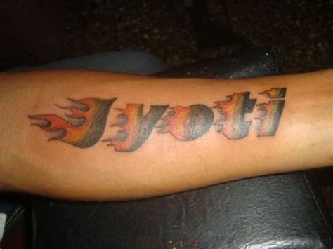 name tattoo on arm jyoti with flames name tattoos