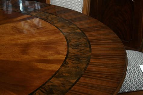 84 034 high end large round mahogany dining table with 2