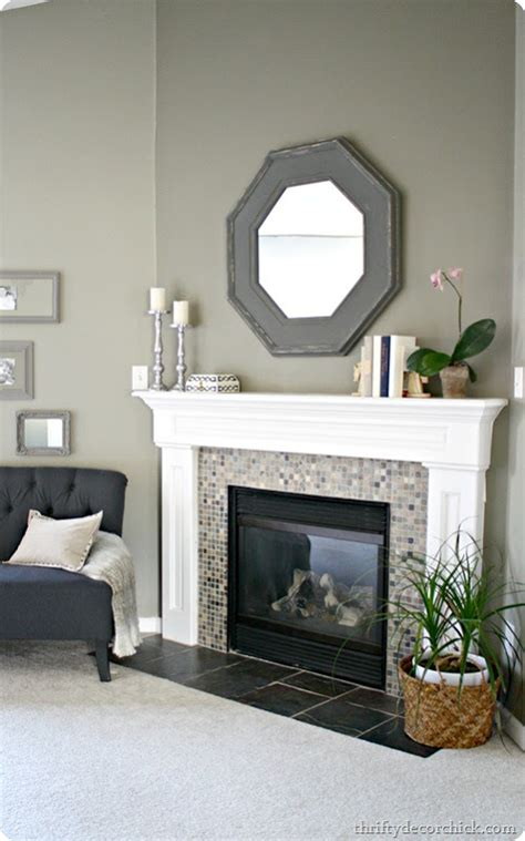How To Decorate A Mantel by Mantel Redo From Thrifty Decor