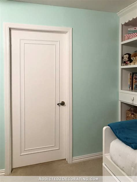 How To Make An Interior Door An Easy Inexpensive Way To Update Flush Flat Panel Interior Doors With Moulding