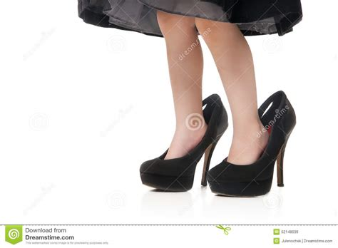 childs in a big black shoes with heels stock image