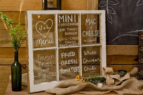 Wedding menu written on glass of vintage window frame