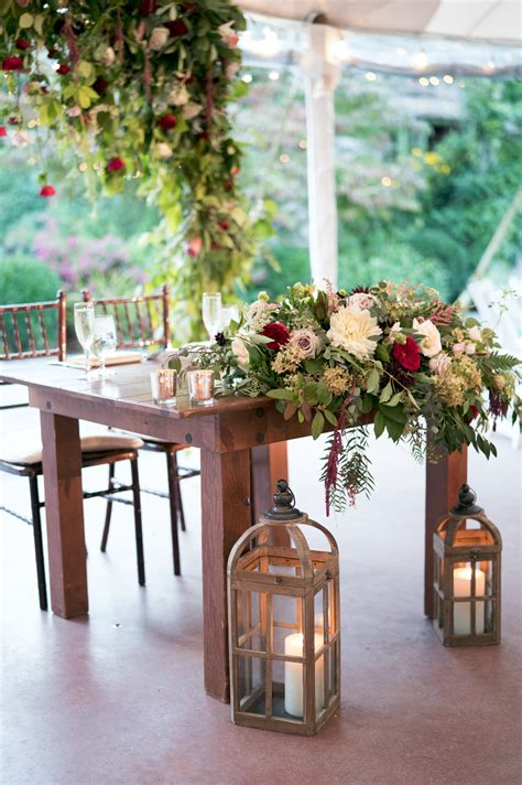 rustic sweetheart farm table  lanterns hanging