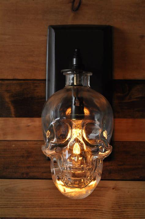 lighting expert creates  spooky skull wall sconce