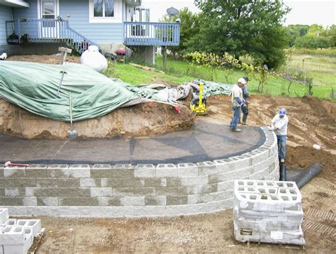 How To Build Retaining Wall On Sloped Backyard a modular block retaining wall reshapes sloping backyard also back yard trends savwi