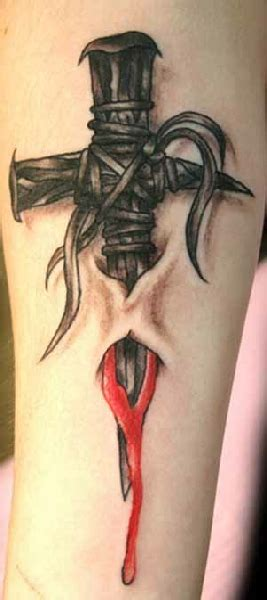cross tattoo ripping out of skin gothic ripped skin cross tattoo