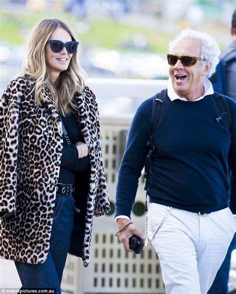 by gilles bensimon elle macpherson elle macpherson sports leopard print coat as she steps out
