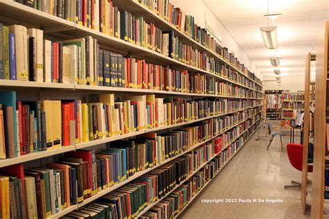 pictures of books in a library shelves and shelves of library books of the designs
