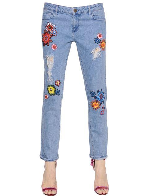 denim house house of holland flower patches on boyfriend denim jeans in blue lyst