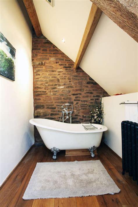 masculine bathroom ideas  exposed brick walls