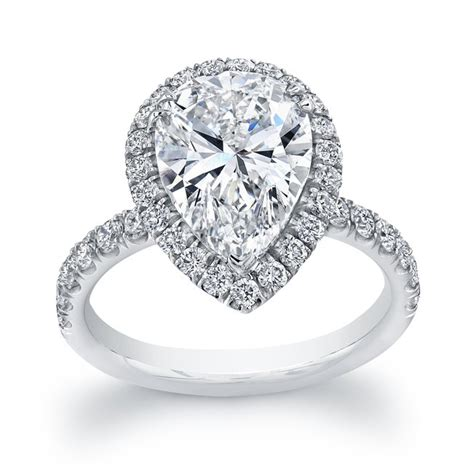 uneek 4 carat pear shaped halo engagement ring