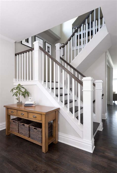 wood plank tile on staircase with white painted railings ideas congress park whole house refresh 171 classic homeworks