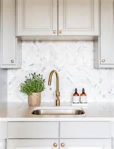 gray cabinets with marble chevron tile backsplash