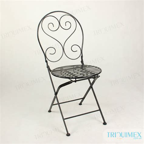 wrought iron folding chair with beautiful decorative patterns