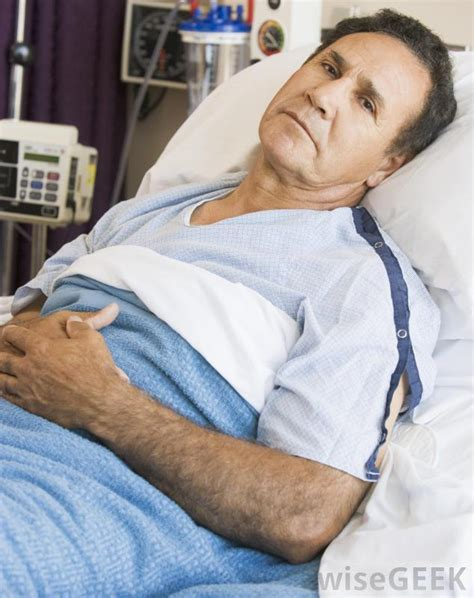 guy in hospital bed what is a malecot catheter with pictures