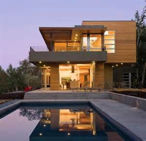 Log siding on a contemporary home windows siding and doors