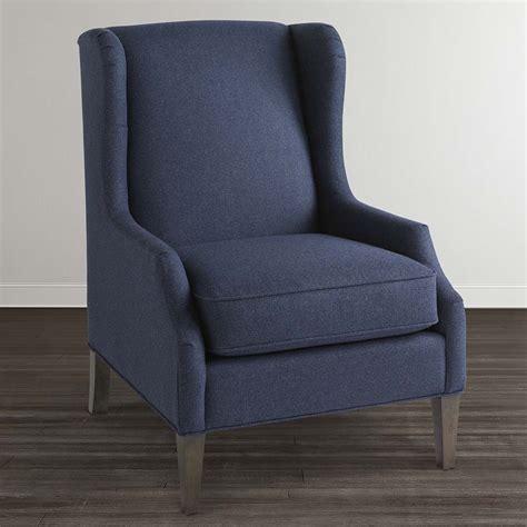 dark blue upholstered arm chair