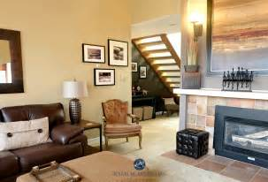 benjamin moore stone house in living room with smoked oyster feature wall and brown leather