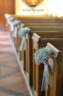 Pew ends of gypsophila decorate alternate pews the look is still full