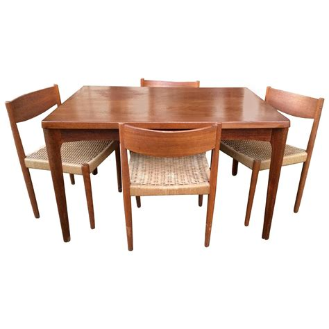Danish Modern Extendable Teak Dining Table With Woven Chairs Room Full Circle | danish modern extendable teak dining table with woven