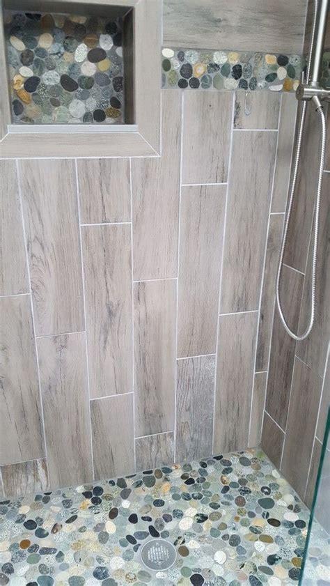 sliced bali ocean pebble tile shower floor  niche