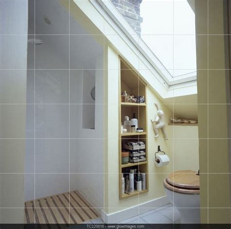 small bathroom open shower velux window above toilet in small attic bathroom with