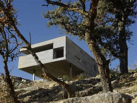 building a house on a slope slope site of house with concrete interior and exterior