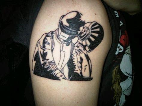 daft punk tattoo on right shoulder
